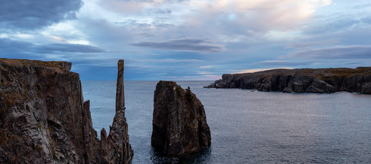 Beautiful panoramic seascape of a rocky Atlantic Ocean Coast during a cloudy sunset. Taken in Spillars Cove, Bonavista, Newfoundland and Labrador, Canada.