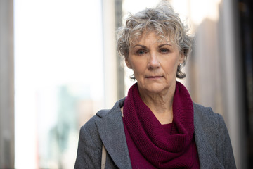 Mature woman in city serious face portrait