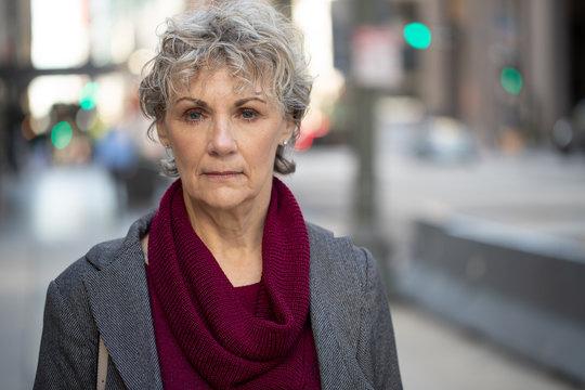 Mature woman in city serious face portrait