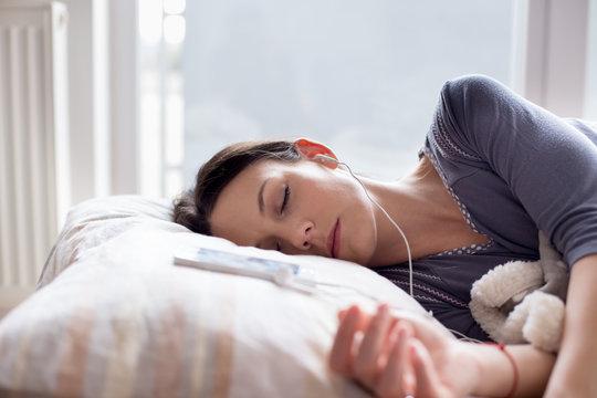 Girl listening music while sleeping