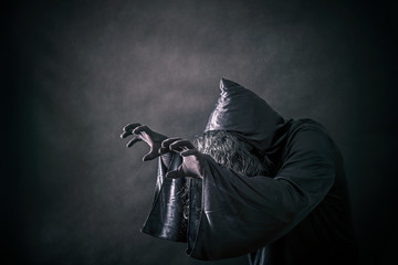 The witch in hooded cloak