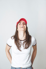 Happy beautiful woman with red hat in studio