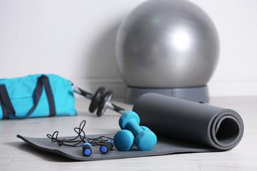 Set of fitness equipment on floor indoors
