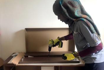 Drame, an employee at odd-jobs platform Task Rabbit, assembles IKEA furniture at the apartment of customer Jessica Resnik in Washington Heights