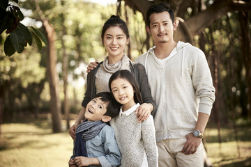 outdoor portrait of asian family