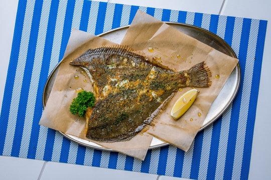 fried flounder on a plate