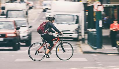 Woman riding bike on city street