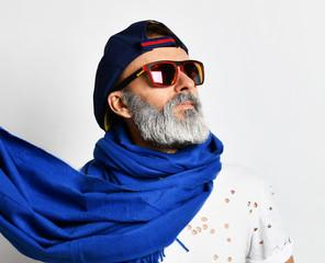 Brutal senior rich man in white designer t-shirt cap and long blue scarf stylish fashionable men