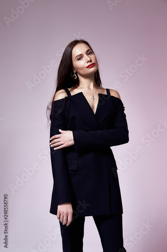 7ade5337fd1 Beautiful sexy young business woman brunette hair evening makeup wearing dress  black suit jacket trousers high heels shoes business clothes for meetings  ...