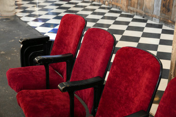 Row of empty red cinema chairs