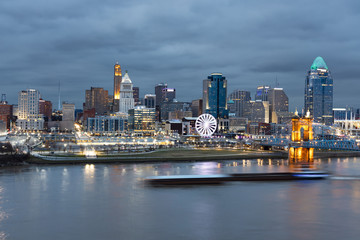 View of Cincinnati Skyline with a Barge Zipping Through the Ohio River