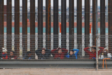 Migrants from Central America are seen escorted by U.S. Customs and Border Protection (CBP) officials after crossing the border from Mexico to surrender to the officials in El Paso
