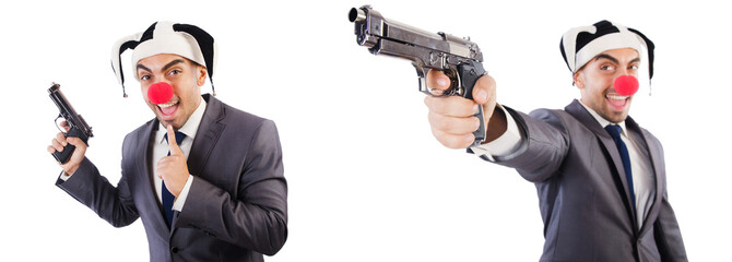 Funny clown businessman with handgun