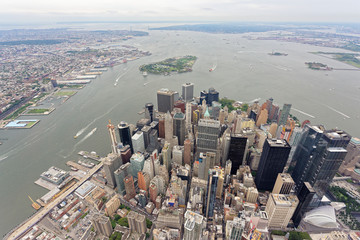 Wide-angle aerial view over Lower Manhattan, looking south towards Governors Island