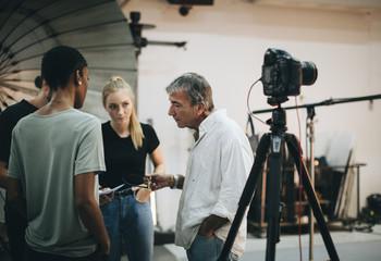 Photographer directing his shoot team