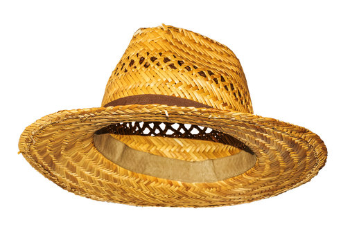 Yellow straw hat on white background side view.