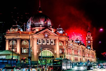 Flinders Street Station at night  with fireworks in the background
