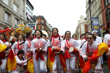 Performers react as they take part in the Chinese Lunar New Year parade through central London