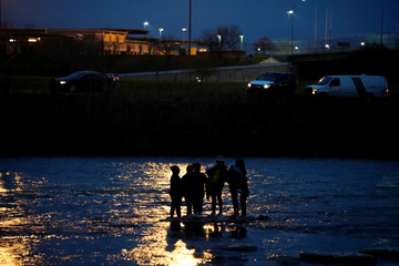 Migrants from Honduras try to cross the Rio Bravo towards the United States, seen from Piedras Negras, Mexico