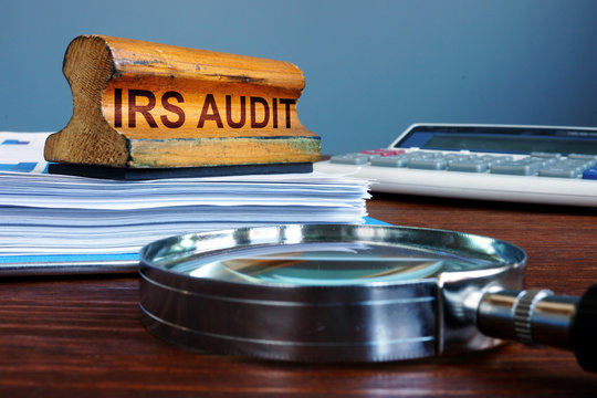 Stamp IRS audit and accounting documents.