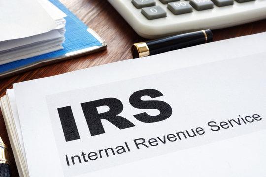 IRS Internal Revenue Service documents and folder.