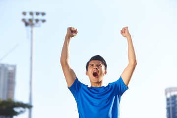 young asian athlete celebrating victory