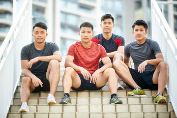 outdoor portrait of four young asian athletes