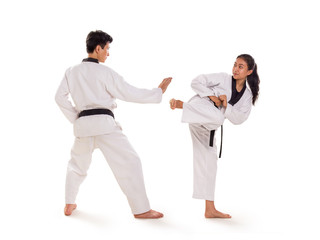 Two young Asian martial art fighters exchanging strikes, full length portrait, isolated background