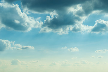 sunlight through cloud on blue sky