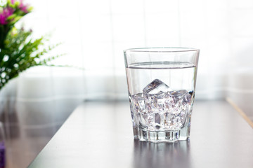 Glass of water on the table background