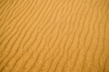 Sand of a beach with wave patterns