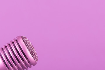 Microphone head. Purple, lilac background.Toning image.Сoncept audio recording, karaoke