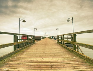 Traditional wooded bridge pier with nobody against sky