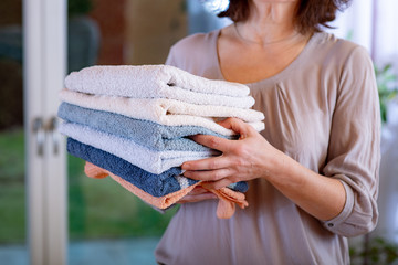 Woman carries towels
