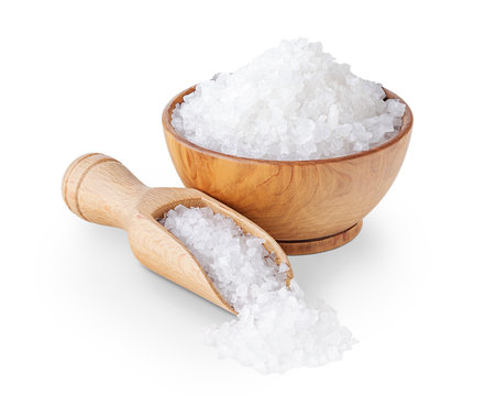 Sea salt crystals in a wooden bowl isolated on white