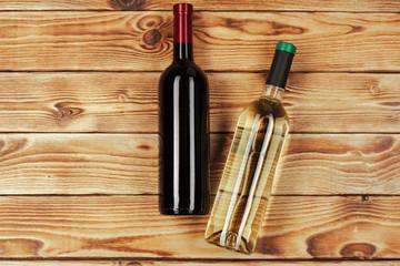 bottle of wine over wooden background