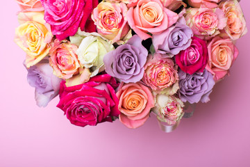 Beautiful bouquet of roses in a gift box. Bouquet of pink roses. Pink roses close-up. on pink background, with space for text.