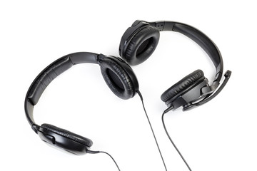 Two pairs of wired ear speakers with full size headphones