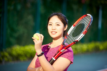 portrait of young female asian tennis player