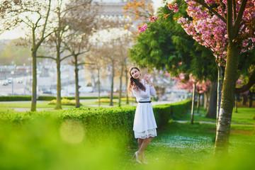 Woman enjoying cherry blossom season in Paris, France