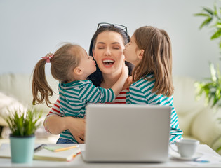 mother with children working on computer