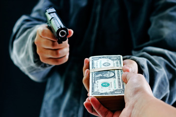 Robber used the gun to robbery the money