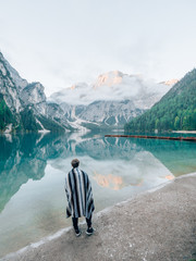 Tourists in front of the Lago di Braies in the Dolomites