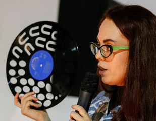 An artist Sorokina conducts a master class during Ukrainian fashion week in Kiev