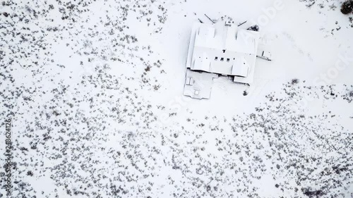 Canvas Prints Aerial view of the mountain house covered in snow in the Winter.