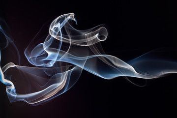 Blue and white smoke on black background