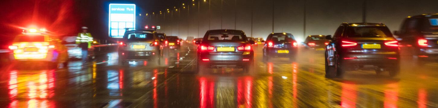 Motion Blur British Motorway Traffic and Police Panorama