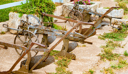 Ancient iron plows on a farm in the countryside of Puglia