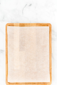 Wooden Cutting Board with White Parchment as Food Background