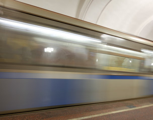 The train moves to the subway as a background